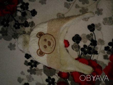 Продам зимнюю шапочку на 1 годик состояние отличное.. Чернигов, Черниговская область. фото 1