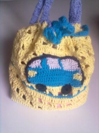 Продам кепку и рюкзак, связанные крючком из детской пряжи. Цвет на фото немного . Запорожье, Запорожская область. фото 4