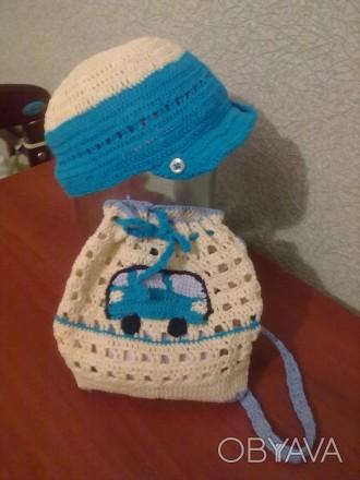 Продам кепку и рюкзак, связанные крючком из детской пряжи. Цвет на фото немного . Запорожье, Запорожская область. фото 1