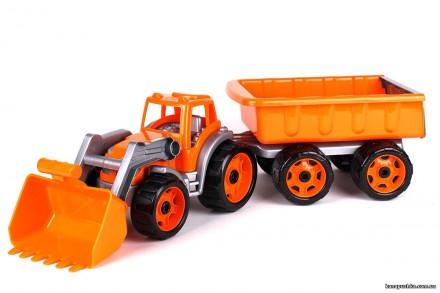 Трактор с ковшом и прицепом стройтехника. Чернигов. фото 1