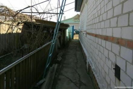 Продаю хороший, тёплый кирпичный дом, построен на основе шпал. Стоят мет.пластик. Городня, Черниговская область. фото 4