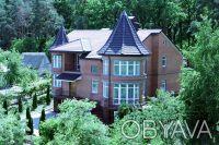 Коттедж расположен на живописном участке 15 соток с выходом в сосновый лес, рядо. Горенка, Киевская область. фото 2