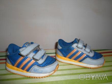 Продам детские кроссовки на мальчика. Цвет синий с оранжевыми полосками.. Днепр, Днепропетровская область. фото 1