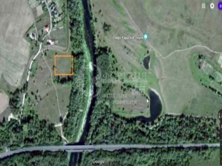 Продам участок земли на берегу р.Снов 2км. от Эко отеля
