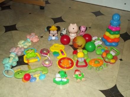 Продам детскую игрушку на коляску и погремушки.. Каменское. фото 1