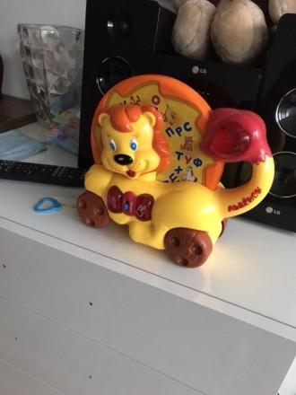 Музыкальная каталка умный львенок в новом состоянии. Васильков. фото 1