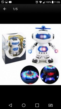 Танцующий робот с музыкой.. Славутич. фото 1