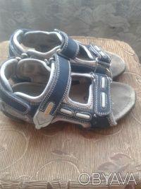Продам сандалии в нормальном состоянии.Длина стельки 19 см.Все следы носки видно. Киев, Киевская область. фото 3