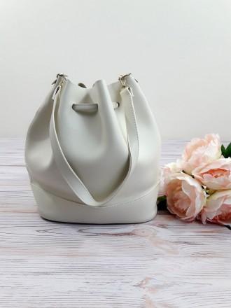 Отличная модель модной сумочки-торбы грушевидной формы, выполненной в классическ. Запорожье, Запорожская область. фото 5