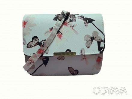 Бежевая женская сумочка с яркой летней расцветкой в цветах и бабочках создает не. Запорожье, Запорожская область. фото 1