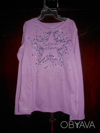 1)Сиреневая футболка на 7-8 лет,с рисунком,в отличном состоянии, CALVIN  KLEIN,. Киев, Киевская область. фото 1