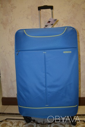 Чемодан валіза на 4 колесах. голубого кольору функція збільшення обсягу. Вбудов. Львов, Львовская область. фото 1