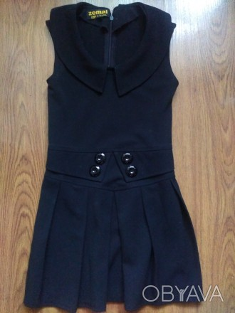 Продам в отличном состоянии сарафан девочке в школу, цвет черный, сзади на молни. Запоріжжя, Запорізька область. фото 1