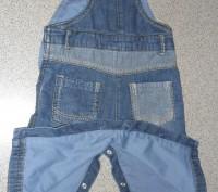 джинсовый комбинезон очень качественный украшен апликациями есть пуговицы,с помо. Запорожье, Запорожская область. фото 5