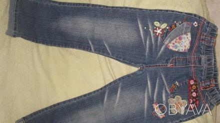 джинсы для девочки 7-8 лет с аппликациями в отличном состоянии. Длина изделия -7. Житомир, Житомирская область. фото 1