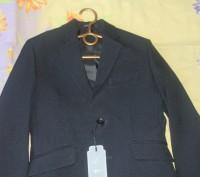 Пиджак новый на мальчика,красивый темно синий цвет,почти черный,на пуговицах,раз. Киев, Киевская область. фото 3