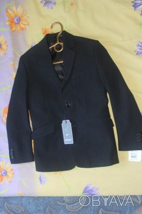 Пиджак новый на мальчика,красивый темно синий цвет,почти черный,на пуговицах,раз. Киев, Киевская область. фото 1