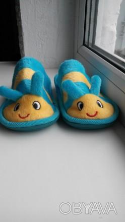 Тапочки состояние нових на фото видно сзади резиночки для удобства в носке. Козелец, Черниговская область. фото 1