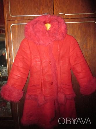зимнее пальто на девочку 8-10 лет,в отличном состоянии,очень теплое,капюшон отст. Суми, Сумська область. фото 1