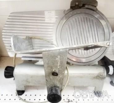 Слайсер Kuchenbach EC300B б/у предназначен для быстрой и аккуратной нарезки всев. Киев, Киевская область. фото 1