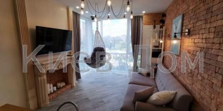 Одна из самых уютных и стильных дизайнерских квартир из экологически чистых мате. Печерск, Киев, Киевская область. фото 4