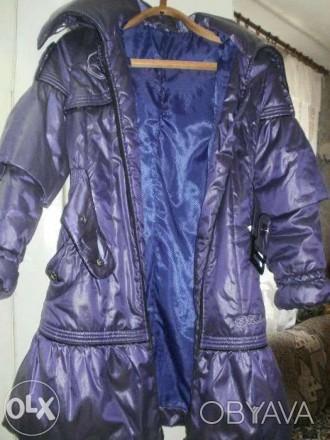 Продам пуховик на девочку 6 -10 лет ,очень теплый ,легкий и не продуваемый.длина. Никополь, Днепропетровская область. фото 1