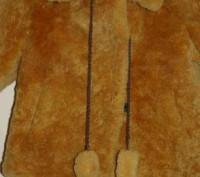 Продаю детскую цигейковую шубку. Очень красивый рыжий цвет. Новая. Размер 26-28.. Киев, Киевская область. фото 3