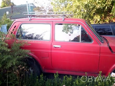 Нива, первый владелец, газ/бензин, высокая новая резина, водительское и пассажир. Днепр, Днепропетровская область. фото 1