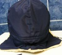 отличная очень теплая шапка,не промокает,верх-плащевка,внутри-иск.мех,состояние . Киев, Киевская область. фото 4