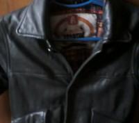 Утепленная кожаная куртка на мальчика, носили до -7.. Радомышль, Житомирская область. фото 3