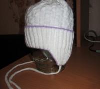1-2.Тёплая осенняя шапочка.Плотная вязка.Подходит и для мальчиков и для девочек.. Житомир, Житомирская область. фото 3