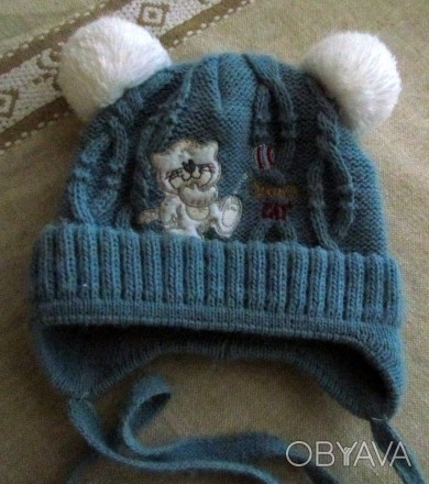 Продам теплую зимнюю шапочку. Вязаная, подкладка - флис. Подойдет для деток с р. Бровары, Киевская область. фото 1