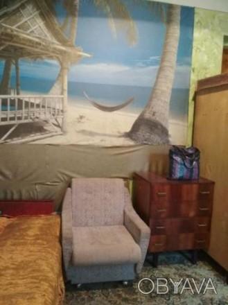Продам комнату в трехкомнатной квартире в Центре