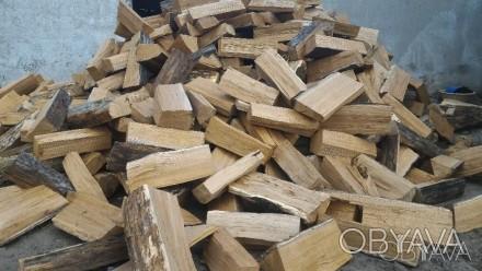 Дрова дубові (колоті; довжиною 40-50 см. та довжиною до 1 м.