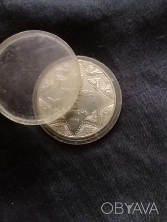 Коллекционая монета
