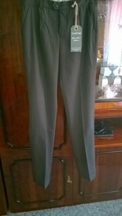 Продам новые качественные брюки подростковые. ПО в поясе 38 см (есть утяжка), ПО. Боровая, Харьковская область. фото 2