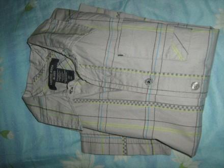 Тениска для мальчика 100%катон,серенькая в клетку,есть карманчик,пуговицы все на. Киев, Киевская область. фото 4