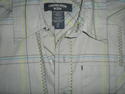 Тениска для мальчика 100%катон,серенькая в клетку,есть карманчик,пуговицы все на. Киев, Киевская область. фото 3