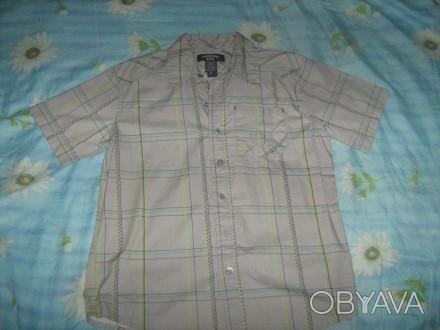 Тениска для мальчика 100%катон,серенькая в клетку,есть карманчик,пуговицы все на. Киев, Киевская область. фото 1