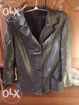Продам . темно-синий б\у кожаный пиджак -длина пиджака 68 см, ширина спинки53 см. Кропивницкий, Кировоградская область. фото 6