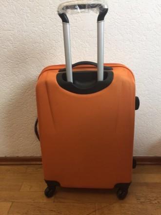 Яркий оранжевый пластмассовый чемодан обтянутый тканью с расширением в 5 см. Мат. Киев, Киевская область. фото 5