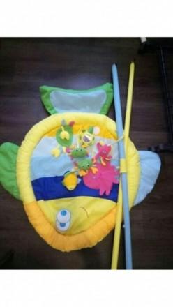 Продам развивающийся коврик Baby Tully Рыбка. На дугах, которыми оснащен коврик,. Кодима, Одеська область. фото 2