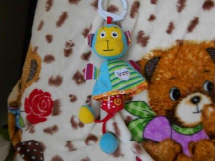 Игрушки подвески в очень хорошем состоянии, апельсин Tiny Love, с вибрирующим ап. Баштанка, Миколаївська область. фото 4