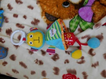 Игрушки подвески в очень хорошем состоянии, апельсин Tiny Love, с вибрирующим ап. Баштанка, Миколаївська область. фото 5
