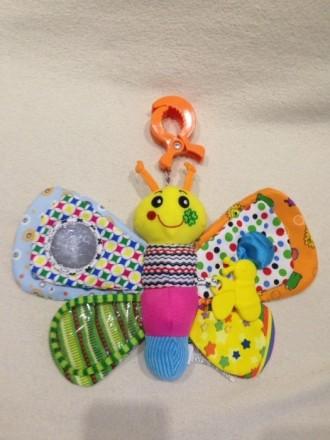Игрушка в отличном состоянии, каждое крыло разного цвета и текстуры, пищалка, гр. Одеса, Одеська область. фото 2