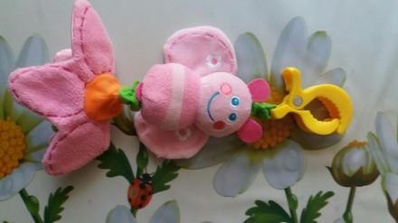Іграшка в хоршому стані. Відтягується квіточка вібрує і дзвепить. Прищепка трима. Луцьк, Волинська область. фото 3