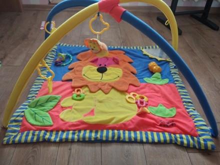 Развивающий коврик тигриный, в хорошем состоянии) на фото это все игрушки к нему. Киев, Киевская область. фото 3