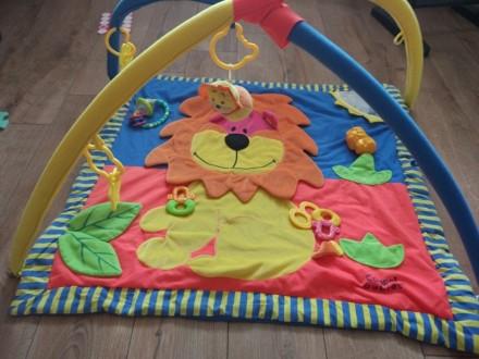 Развивающий коврик тигриный, в хорошем состоянии) на фото это все игрушки к нему. Киев, Киевская область. фото 4