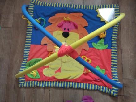Развивающий коврик тигриный, в хорошем состоянии) на фото это все игрушки к нему. Київ, Київська область. фото 5