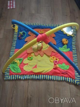 Развивающий коврик тигриный, в хорошем состоянии) на фото это все игрушки к нему. Киев, Киевская область. фото 1